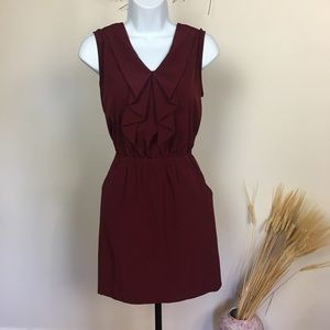 Sleeveless XTAREN dark red dress with pockets.